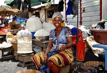 Portrait Of Woman Sitting At Market Stall