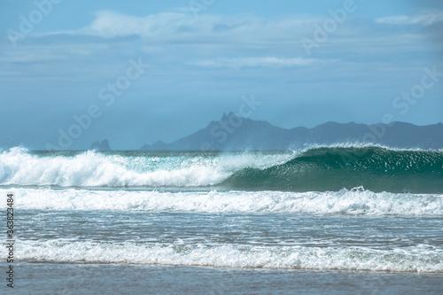 Pacific Ocean waves crashing on the beach. Whangarei, New Zealand © sardinelly