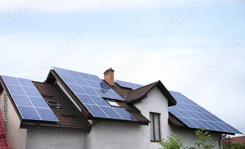 Obraz House with installed solar panels on roof. Alternative energy source - fototapety do salonu
