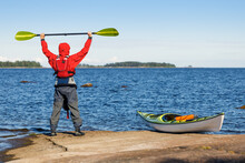 Happy Man With A Sea Kayak On ...