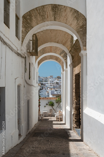 Fototapety, obrazy: Beautiful empty street in southern Spain with a viewpoint overlooking the white village.