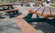 Empty Picnic Tables In The Park
