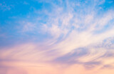 Fototapeta Na sufit - soft blue sunset sky with light pink clouds