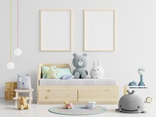 Picture Frames Hanging On Wall Over Toys At Home