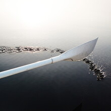Close-up Of Oar On Lake