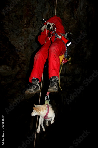 Valokuva Low Angle View Of Man Rescuing Dog