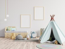Tent With Toys Against Blank Picture Frames At Home