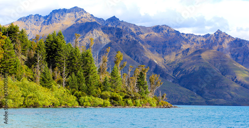 Georgeous landscapes, lush green meadows, moutains and clear blue waters near Glenorchy, New Zealand