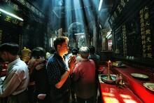 People Praying At Place Of Worship