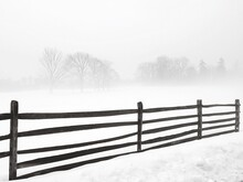 Wooden Fence On Snow Covered Landscape