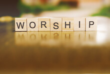 The Word WORSHIP Written In Wo...