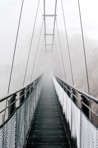 Fotografiet Empty Narrow Footbridge Against The Sky