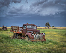 Old, Abandoned Vehicles On The Great Plains As Severe Weather Approaches