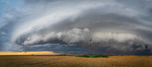 Windmills On The Great Plains As Storms Approach