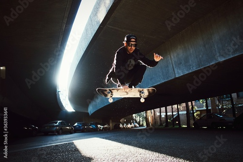 Tablou Canvas Low Angle View Of Man Jumping On Skateboard
