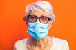 Leinwanddruck Bild - Senior woman with protection mask during covid-19 pandemic