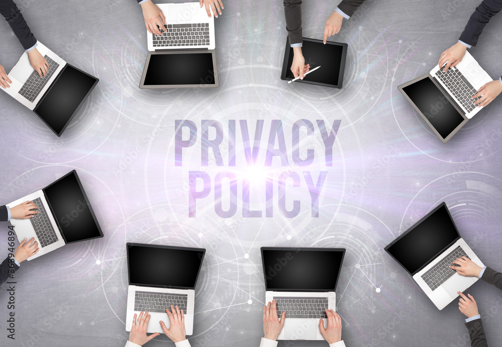Fototapeta Group of people in front of a laptop with PRIVACY POLICY insciption, web security concept