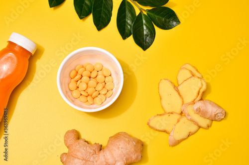 Fotografia, Obraz Ginger in different conditions: fresh, dry root, pills and cut plant on pastel yellow orange background