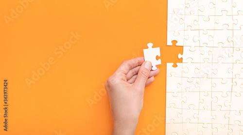 Obraz na plátně Business concept of white jigsaw puzzle.
