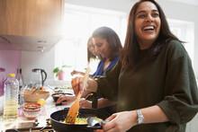 Happy Indian Women Cooking Foo...