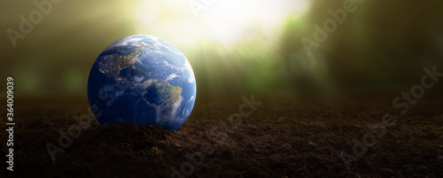 Fototapeta planet earth on soil for plants - environmental care concept - Elements of this image furnished by NASA obraz
