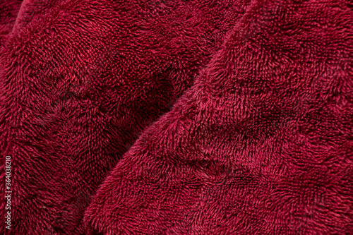 large red towel crumpled as a background closeup Canvas-taulu