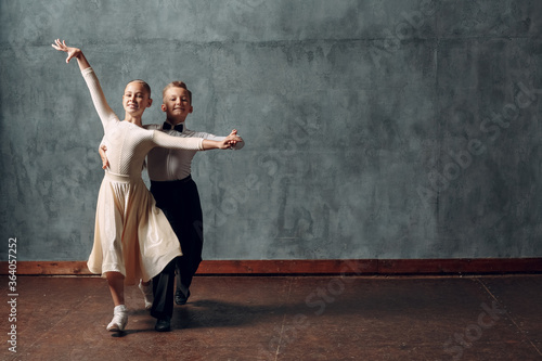 Young couple boy and girl dancing in ballroom dance Viennese Waltz Canvas Print