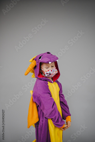 Beautiful Young Girl With Nose And Mouth Mask Dressed In Dragon Costume During Corona Crisis Buy This Stock Photo And Explore Similar Images At Adobe Stock Adobe Stock