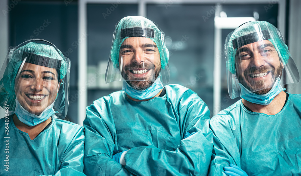 Fototapeta Surgeons smiling after a successful surgical operation - Medical workers the real heroes during corona virus outbreak - Doctor working for stop and preventing spread of coronavirus concept