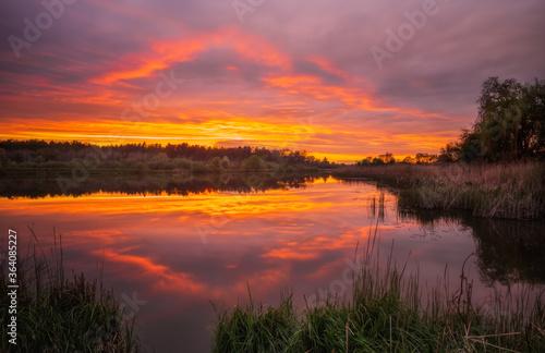Long exposure fantastic sunset view on Bartatov Bartativ, Morozy village region Lviv. Lake and forest. Lviv district, Ukraine. May 2020 #364085227