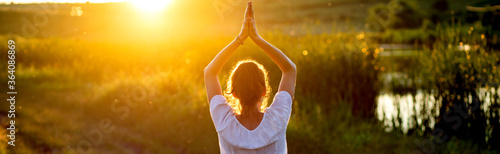 Fotomural woman in a yoga pose at sunset by lakeside mindfulness and mental health