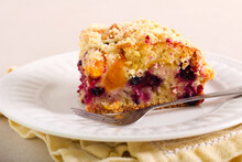 Fruit And Berry Cake With Crumble Topping
