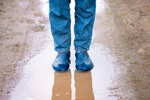 Legs Of A Woman In Rubber Boot...
