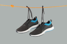 Men's Sport Shoes Hanging On R...