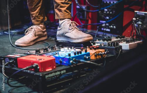 Fotografie, Obraz Colorful Guitar Pedals at Concert