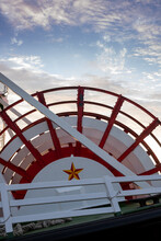 Paddle Wheel And Cloudy Blue Sky