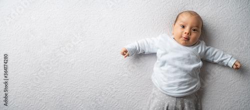 Obraz newborn baby boy on a white blanket - fototapety do salonu