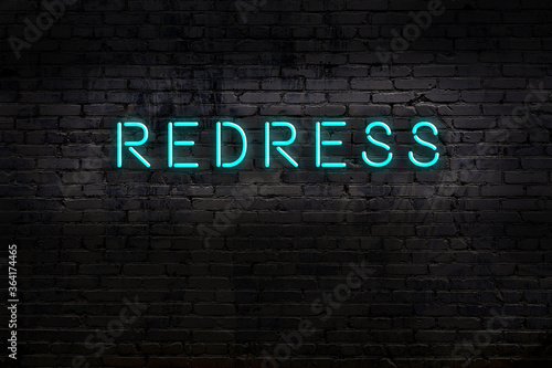 Night view of neon sign on brick wall with inscription redress Wallpaper Mural