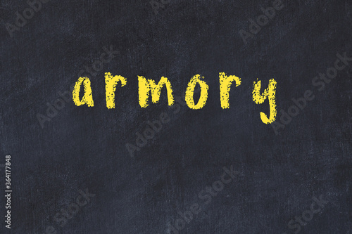 Photo College chalk desk with the word armory written on in