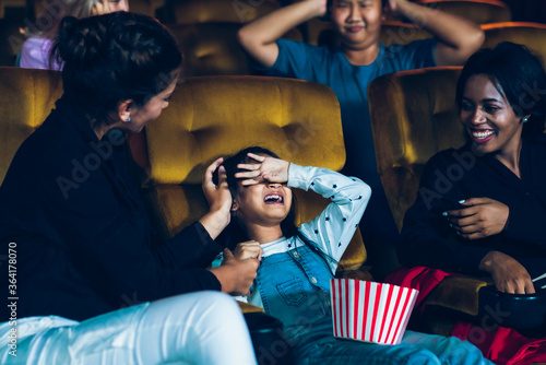 The girls cried loudly in the cinema, causing annoyance to the people sitting next to and behind them Canvas Print