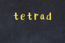 College Chalk Desk With The Word Tetrad Written On In