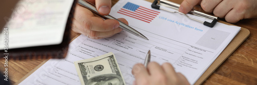 Fotografija Dollars and passport are visa application form usa