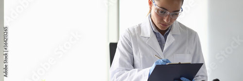 Portrait of concentrated woman looking at documents with seriousness Fototapet