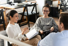 Smiling Multiethnic Young Colleagues Have Fun Take Part In Educational Motivational Training In Office, Happy Diverse Multiracial Employees Engaged In Teambuilding Activity At Meeting Or Briefing