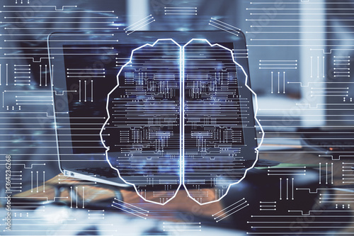 Double exposure of work table with computer and brain sketch hologram. Brainstorming concept.