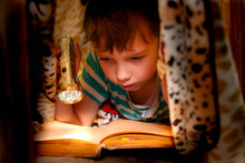The Child Carefully Reads The ...