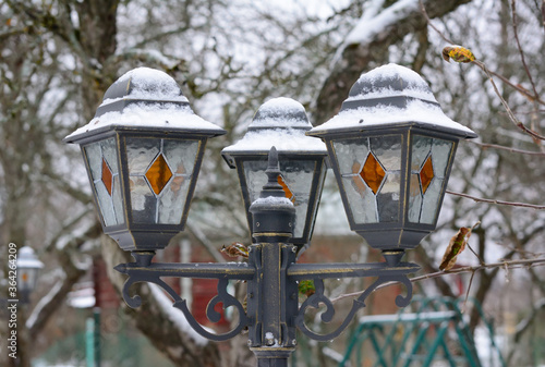 Old street lamp with frost