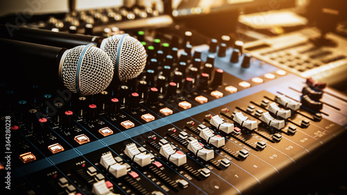 Fotografie, Obraz Microphone with sound mixer in studio workplace for live the media and sound recording equipment and sound system concept