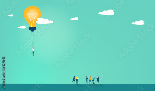 Business person flying with light bulb Fototapeta