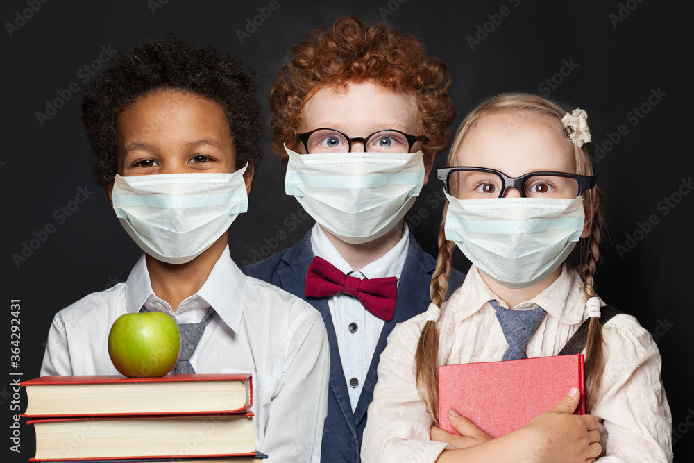 Fototapeta Children in protective face mask on black background, back to school and covid-19 concept